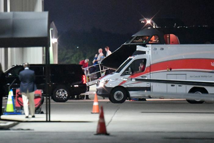 A person believed to be Otto Warmbier is transferred from a medical transport airplane to an awaiting ambulance at Lunken Airport in Cincinnat