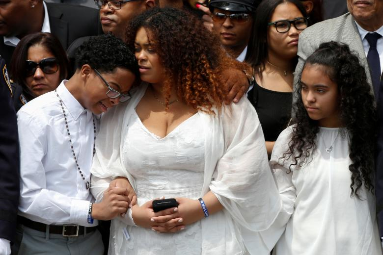 Family members of slain New York City Police Department (NYPD) officer Miosotis Familia stand outside the World Changers Church following her funeral service in the Bronx borough of New York City