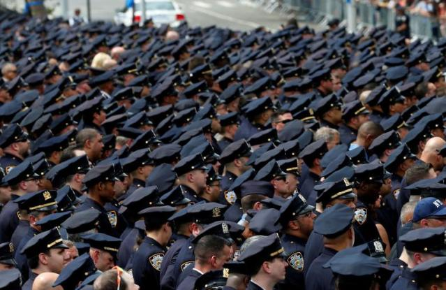 Police officers gather for the funeral service for slain New York City Police Department (NYPD) officer Miosotis Familia in the Bronx borough of New York City