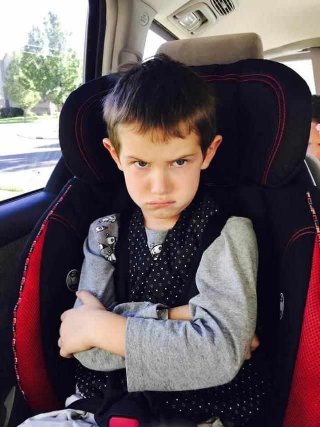 Mom Hitting Screaming Son in Car