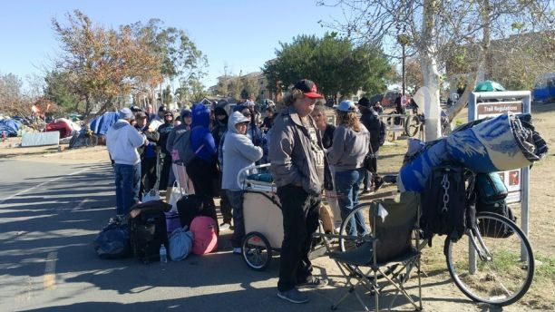 Homeless people prepare to move from their camp