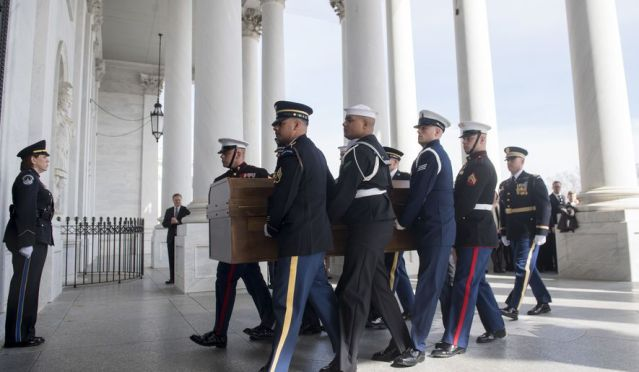 A Military Honor Guard carries the casket of Reverend Billy Graham