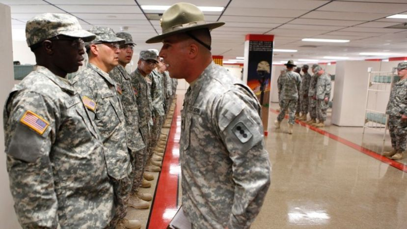 A drill sergeant scolds one of his recruits
