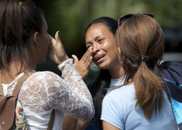 Tormented relatives of 68 people killed in a fire at a Venezuelan police station jail