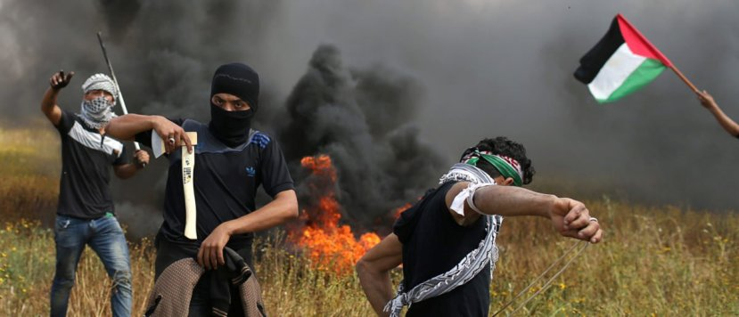 A Palestinian demonstrator holds an axe during clashes with Israeli troops