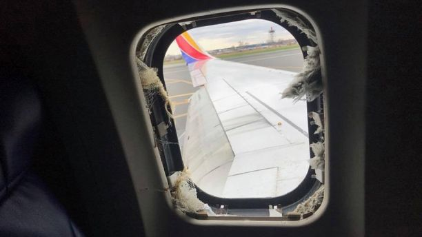 The window that a passenger was reportedly partially sucked ou