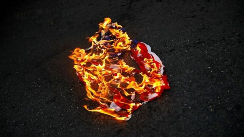 Police arrested three May Day protesters for setting fire in a city park,