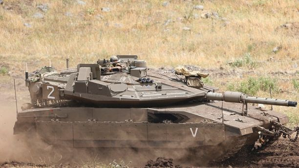 May 10, 2018: An Israeli Tank drives in the Israeli-controlled Golan Heights,