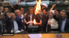 "Iranian lawmakers shouted ""death to America"" and set fire to a paper U.S"