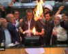 """Iranian lawmakers shouted """"death to America"""" and set fire to a paper U.S"""