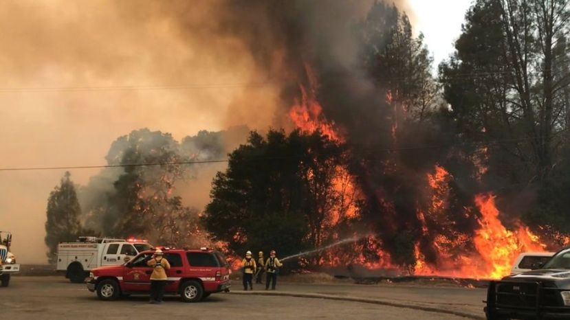 Firefighters battle the wildfire