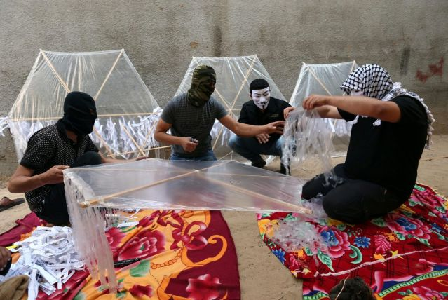 Palestinians preparing kites loaded with flammable material