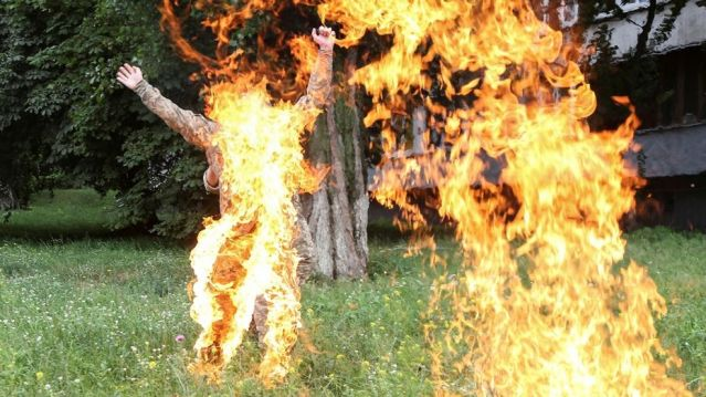 Ukrainian serviceman Serhii Ulianov sets himself on fire.  (Reuters)