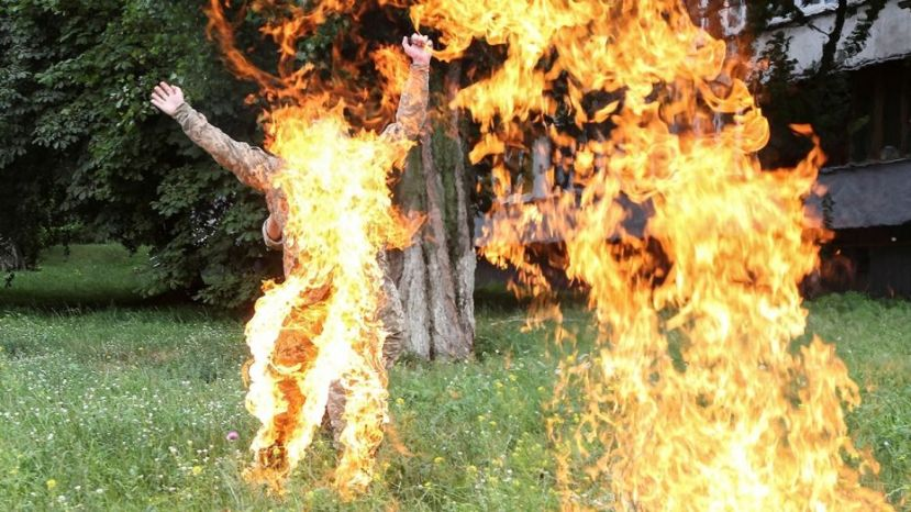 Ukrainian serviceman Serhii Ulianov sets himself on fire.  (Reuters)