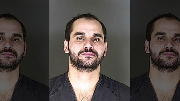 Karrar Noaman Al Khammasi, 31, is accused of shooting Colorado Springs office
