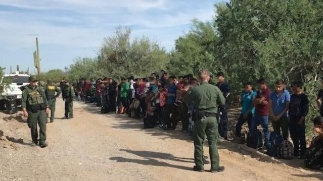 Border Patrol agents stopped on Friday a caravan of 128 people