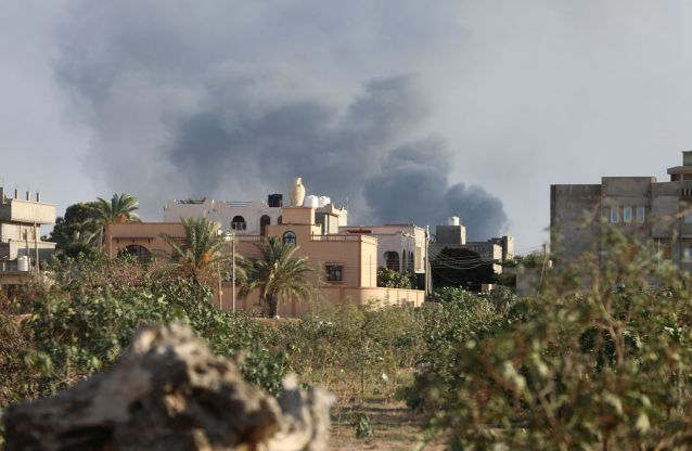Smoke rises during heavy clashes between rival factions in Tripoli,