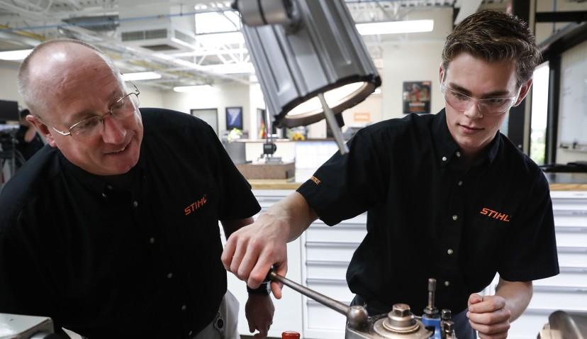 Apprentice Ryan Buzzy, right, works with Skip Johnson, a trainer for the Stihl Inc. apprenticeship program,