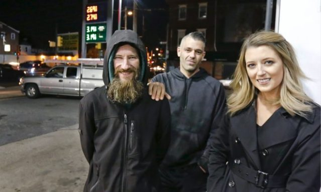 Johnny Bobbitt (L), Kate McClure (R) and McClure's boyfriend Mark D'Amico pose at a Citgo station in Philadelphia.