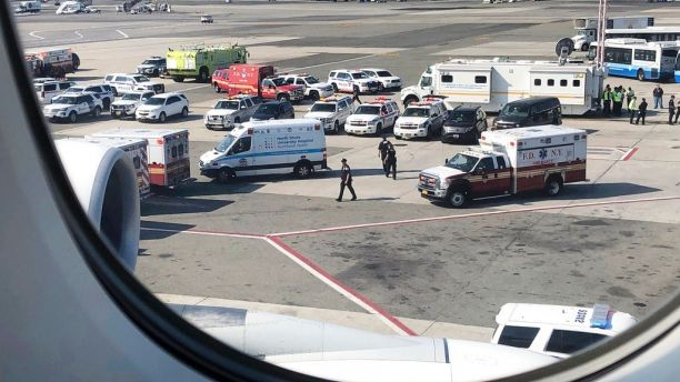 Emergency response crews gather outside a plane at New York's Kennedy Airport