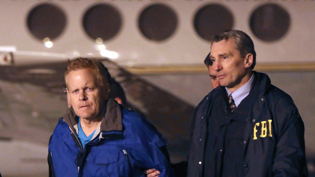 fugitive lawyer Eric Conn, left, is taken into custody by FBI agents