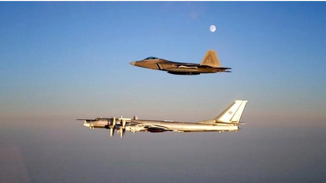 An F-22 Raptor escorts a Russian TU-95 Bear