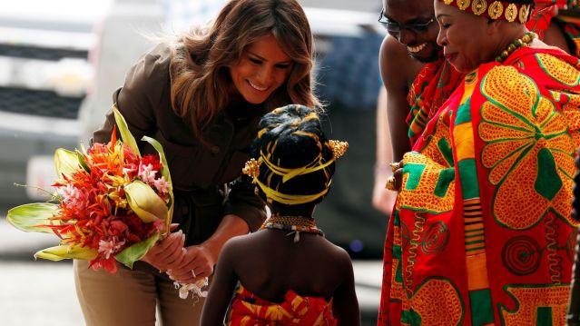 U.S. first lady Melania Trump greets a child