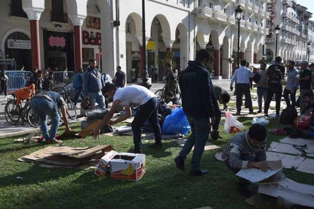 Migrants clear the Aristotelous Square in the northern Greek city of Thessaloniki,