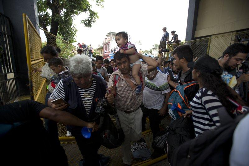 Honduran migrants rush across the border towards Mexico,