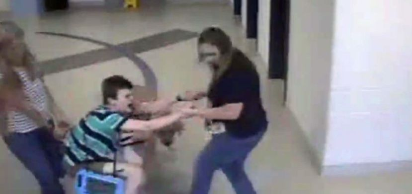 child-with-autism-dragged-thru-school