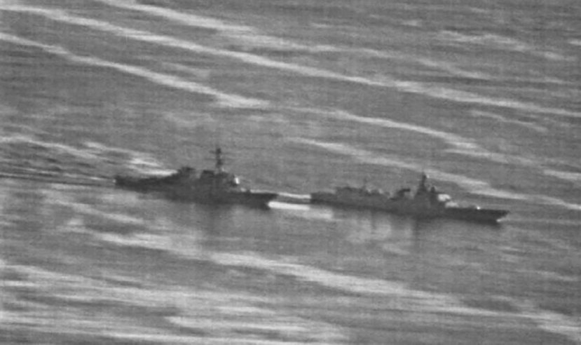 The Chinese warship moves ahead of its US counterpart after forcing the US ship to perform a
