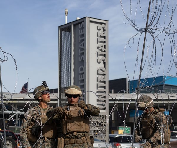 U.S. military personnel install barriers requested at the San Ysidro port of entry in San Diego,
