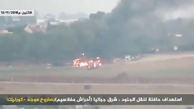 A bus burns near Kfar Aza, Israel, on November 12, 2018, after being hit by an anti-tank guided missile fired