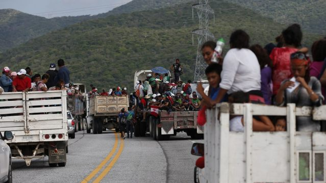 Migrants hitch rides