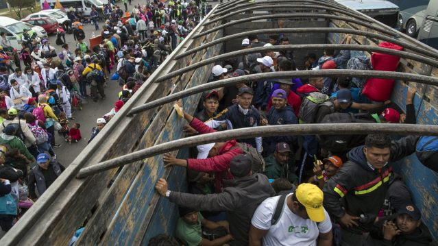 Central American migrants travel on a truck after hitching a ride in Tepotzotlan, Mexico,