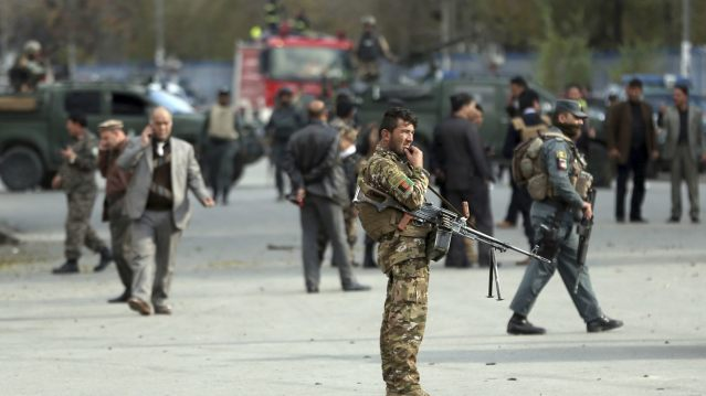 Security forces inspect the site of a deadly blast