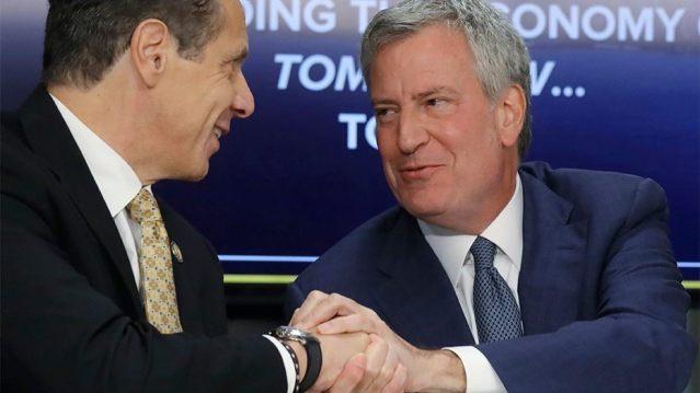New York Gov. Andrew Cuomo, left, and New York City Mayor Bill de Blasio