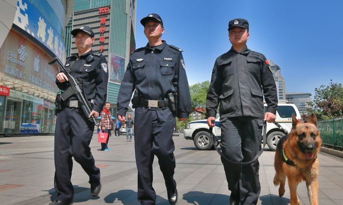 Armed police officers patrol a street in Beijing, China