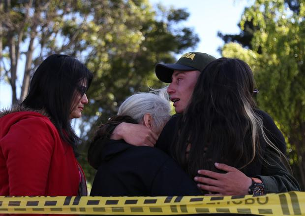 A police officer hugs his relatives
