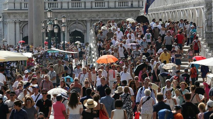 Tourists walk near St. Mark's Square in Venice,