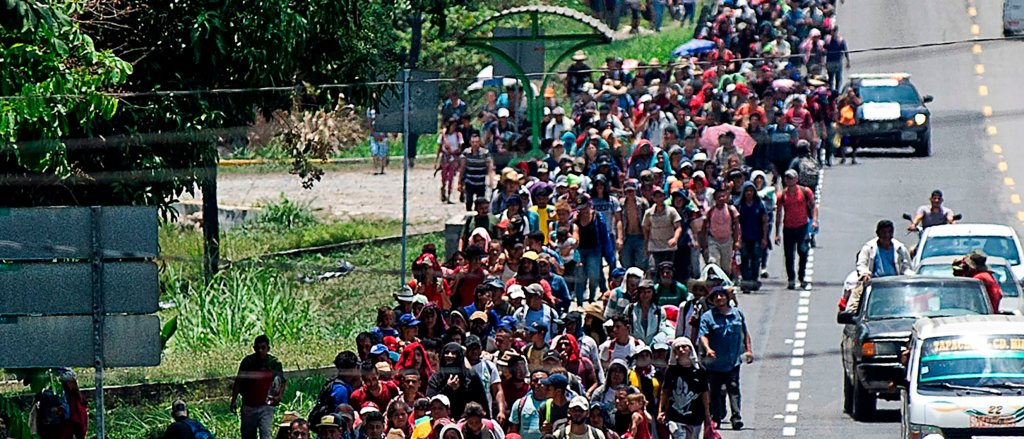 Central American migrants heading to the US walk in caravan