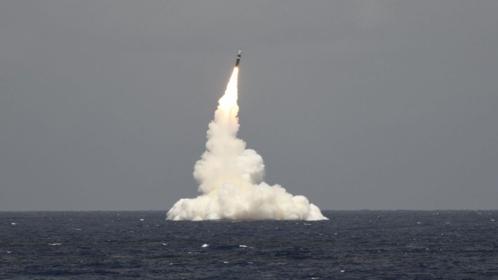 An unarmed Trident II D5 missile launches from the Ohio-class ballistic missile submarine USS Rhode Island