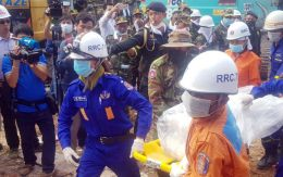 Provincial Authority, rescuers carry the body of a victim at the site of a building collapse on Monday