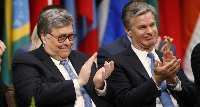 Attorney General William Barr, left with FBI director Christopher Wray, right,