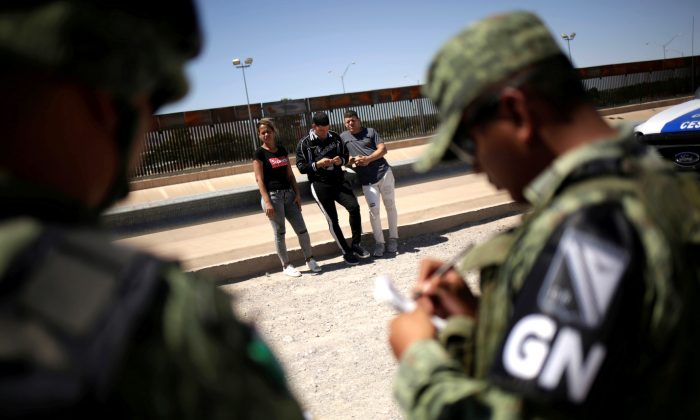 Members of Mexico's National Guard detain Cuban migrants