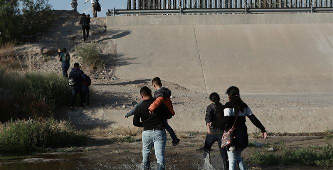 Migrant families cross the Rio Grande to get illegally across the border into the United States,