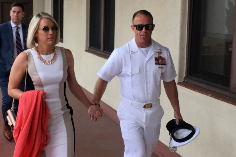 Navy Special Operations Chief Edward Gallagher, right, walks with his wife, Andrea Gallagher
