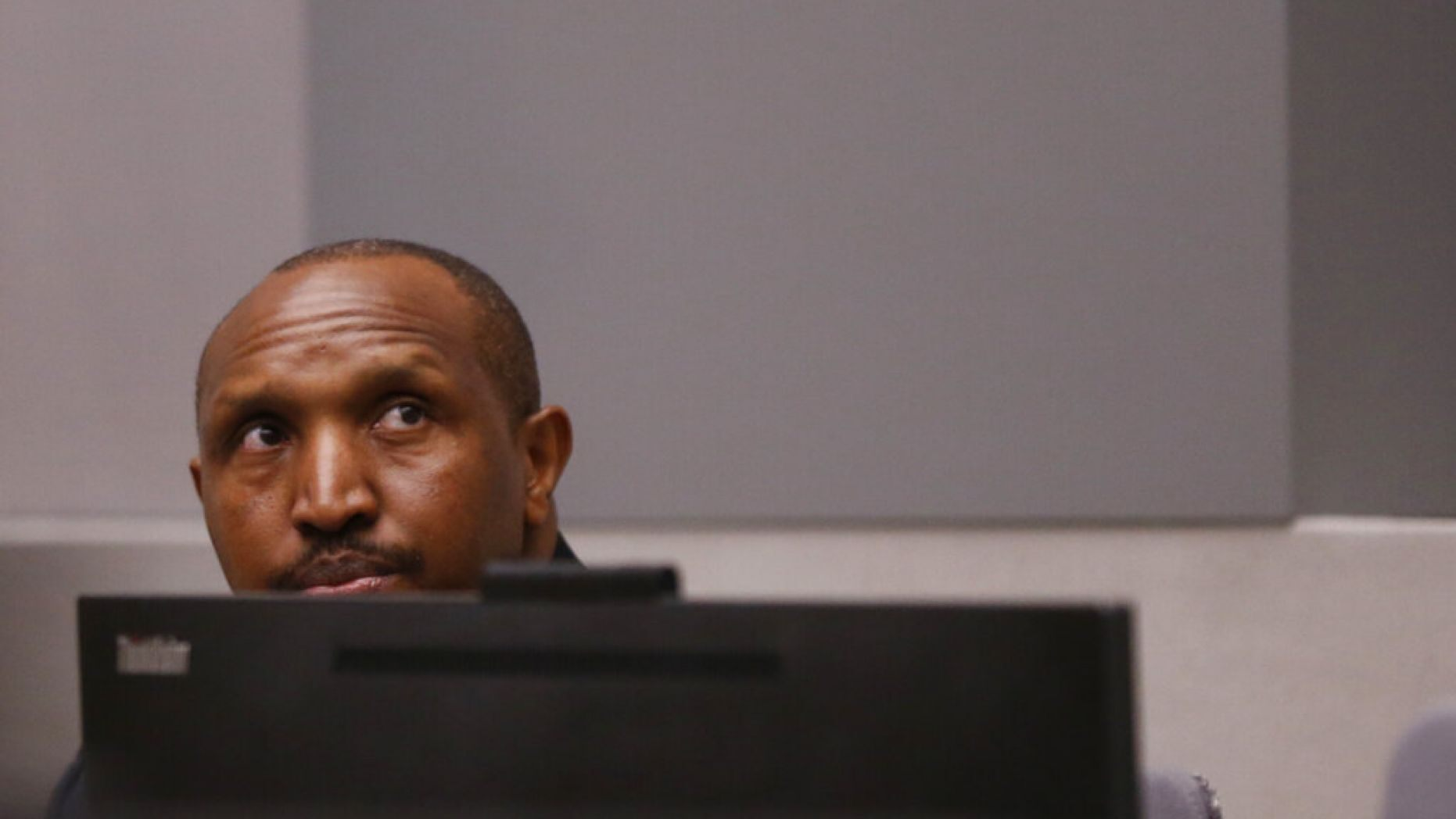 Congolese militia commander Bosco Ntaganda sits in the courtroom of the ICC