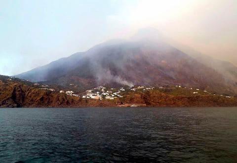 Smoke billows from the volcano on the Italian island of Stromboli, Wednesday, July 3, 2019.