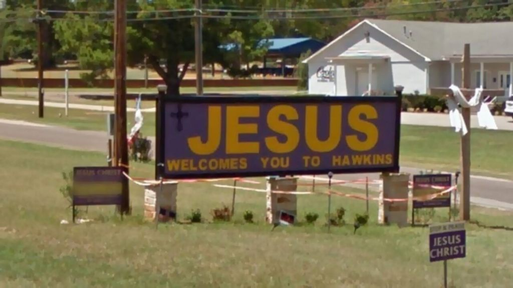 "The city of Hawkins and a church congregation are fighting over a ""Jesus Welcomes You to Hawkins"" sign"